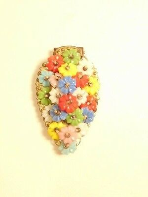 Older dress clip with colorful plastic flowers