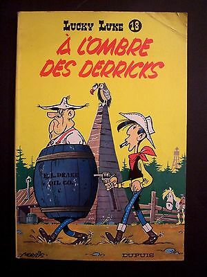 LUCKY LUKE  n°18 A L'ombre des Derricks , reed 1964 , dos jaune , BE