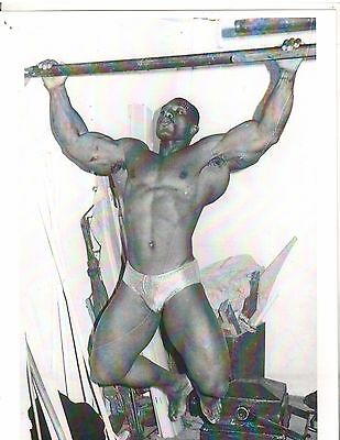 bodybuilder SERGIO OLIVA backstage contest prep wide grip chins muscle b+w photo