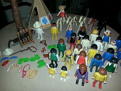 26 playmobil figures, 5 playmobil horses and accessories.