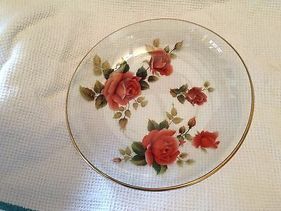 Small glass bowl with a pattern of red roses and a gilded edge