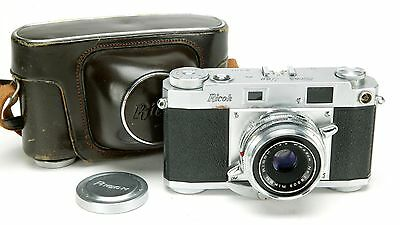 Fantastic Rangefinder Camera Ricoh 500 W/Rapid Winding Crank & Auxiliary Lenses