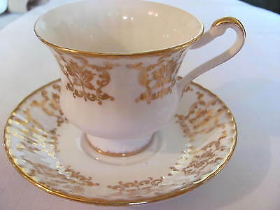 Paragon Bone China  Cup And Saucer  England   White/gold