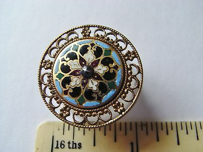 unusual  filigree metal enamel button with a cut steel centre