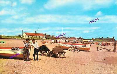 NORFOLK CAISTER ON SEA,GT YARMOUTH FISHING BOATS,HOLIDAY MAKERS RELAXING,1970s