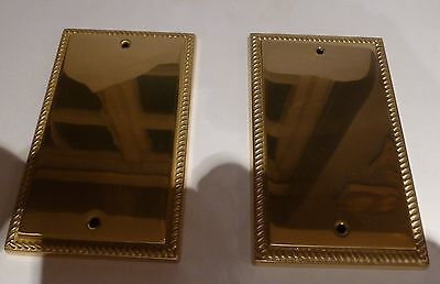 A pair of brass socket 2 gang blanks with beaded rope edge