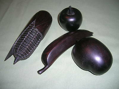 Four Pieces Of Dark Wood Quality Handcarved Wooden Fruit