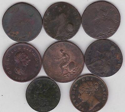 Eight Old Copper Halfpenny Coins In A Well Used Condition Dated 1731 To 1882