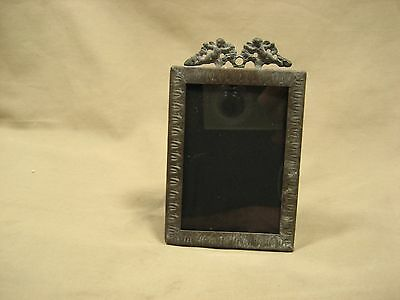 Vintage cherub top  brass finished small picture frame lots of patina
