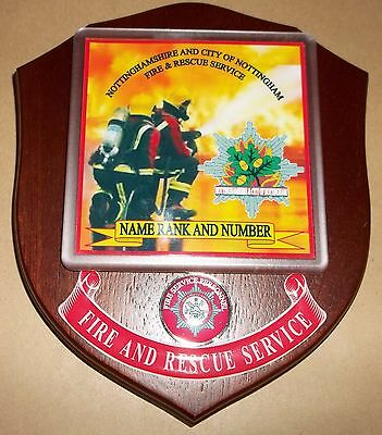 Nottinghamshire and City of Nottingham Fire and Rescue Service wall plaque.