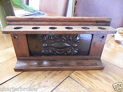 Genuine period Arts & Crafts Smokers Oak 6 Pipe Rack with embossed copper panel