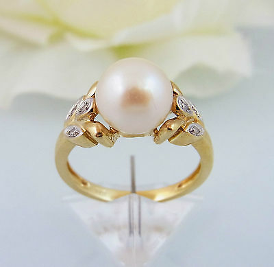reizender Ring Gold 375 Perle & Brillanten Gr. 52 (A1314)