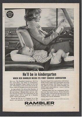1962 Rambler baby laying on seat He'll be in kindergarten woman driver car ad