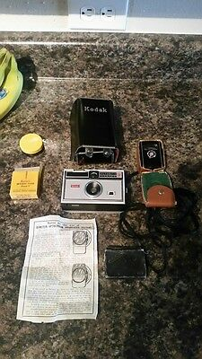 Vintage Kodak Instamatic 104 camera with hard case and htf accessories