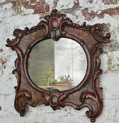 "C18th Mirror In A Finely Carved Silver Gilt Frame. 10"" x 8"". Overall 18"" x 16""."