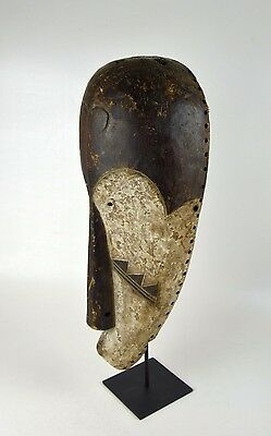 A Very large Fang N'gil African mask on display stand