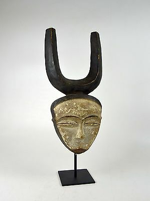 A Very fine Kwele African mask with tall horns on display stand