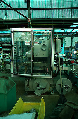 PDC High Speed Sleeve Labeler Model 75-ERL ( last running cups of mini cookies )