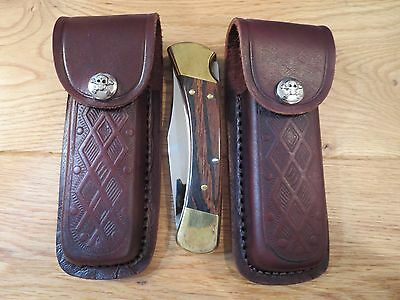 Lot of 2 Skull and cross bones leather knife sheaths. Fits a Buck 110 or similar