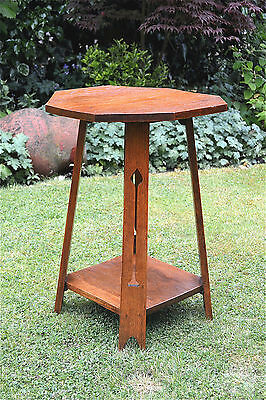 Original Arts and Crafts solid oak lamp table pierced legs C.1900-1910