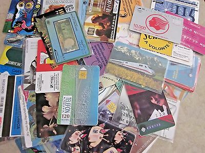 Group of 50 different international phone cards, used