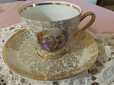 Kahla Chintz  Cup And Saucer   Germany. Gold Chintz/grecian Ladies