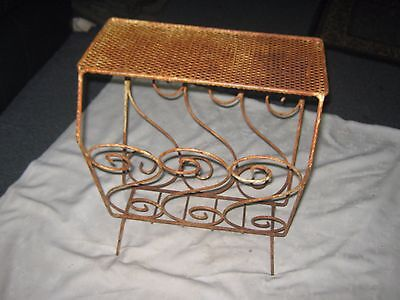 An Old Distressed Industrial Metal Mesh &  Rod Scroll Design Magazine Rack Table