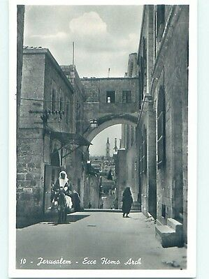 old rppc MAN RIDING DONKEY AND BUILDINGS ON STREET Jerusalem Israel HM1536