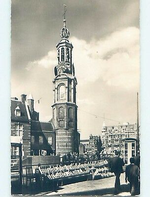 old rppc CLOCK TOWER BESIDE BUILDINGS Amsterdam Netherlands HM1477