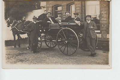 Group of gents in horse drawn carriage