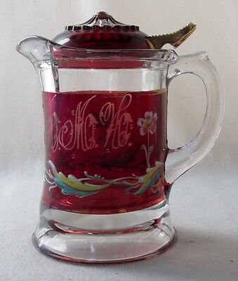 "Enameled ruby stained syrup with glass lid, 6"" h.  EAPG"