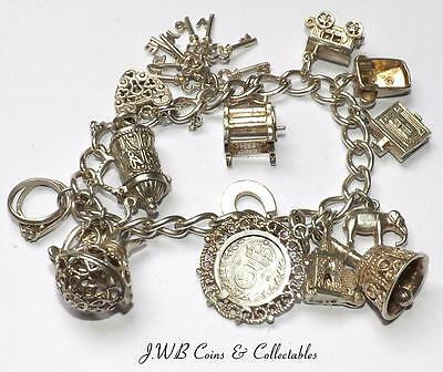 Vintage Sterling Silver Charm Bracelet With 14 Charms - 57 Grams