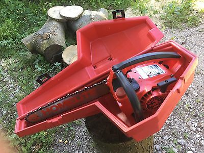 "Vintage homelite super 2 chainsaw with 13 1/2"" cut and case"