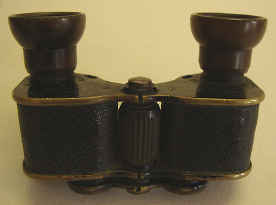 Early 20th century pair of miniature sized pocket binoculars by Ross London