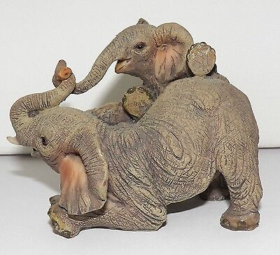 Very Lovely Collectible Figurines Of Elephant Mother And Child At Play In Resin