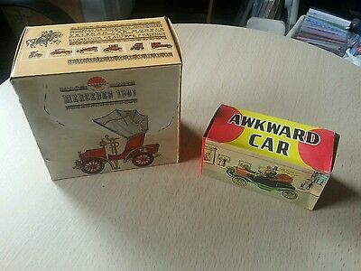 2 vintage boxed cars