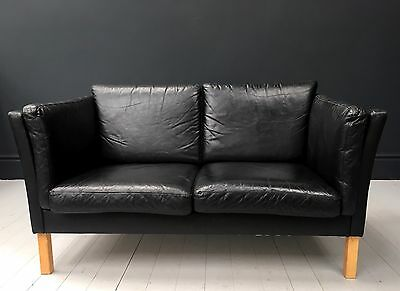 A vintage black leather 2 seater Danish sofa. DELIVERY AVAILABLE.