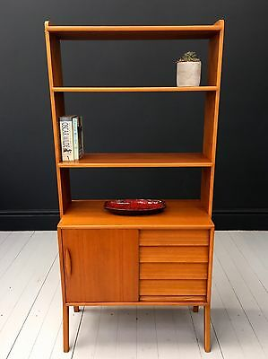 A vintage mid century Swedish teak bookcase cabinet. DELIVERY AVAILABLE.