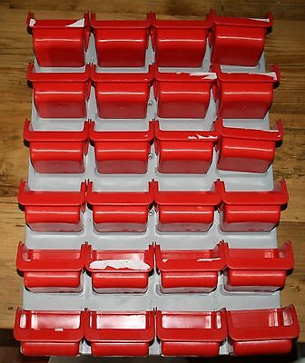 24 RED WALL MOUNTED STORAGE PLASTIC BINS. 42x59cms WALL PLATE