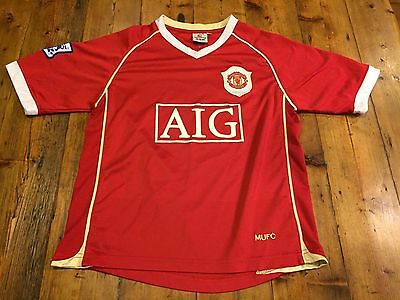 MANCHESTER UNITED Boy's Red Nike AIG Jersey- Size Medium 8/10 years