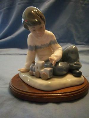 Nao Division Of Lladro Boy With Train Figurine