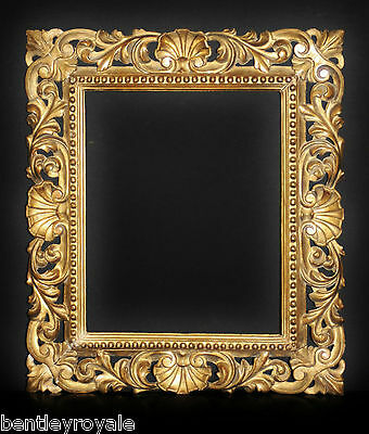 "A Fine C18th Florentine Carved Limewood Picture Frame: Sight Size 25"" x 20""."