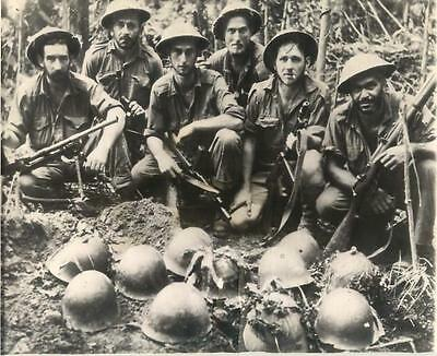 WWII Australian Troops by Japanese Helmets atop Common Grave in New Guinea Photo