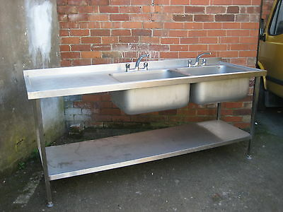 Commercial S/S double bowl sink left hand drainer.