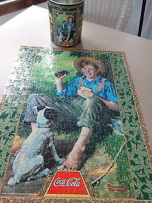 Coca Cola collector tin with jigsaw puzzle boy fishing sealed in original bag