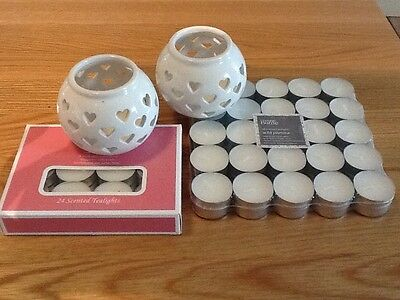 selection of brand new tealight candles with 2 brand new ceramic candleholders