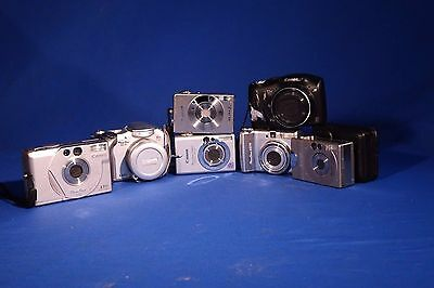 LOT Canon Powershot digital point and shoot cameras. #L124EW