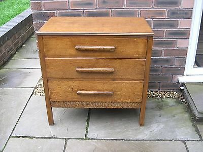 An oak chest of three drawers from the 1930's-1940's