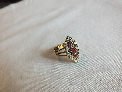 Stunning Gold Tone Cocktail Ring Bright Red Rhinestones Adjusts Signed Coventry