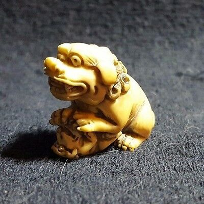 JAPANESE CARVEd BOVINE BONE NETSUKE-Shishi and Baby Shishi-Signed